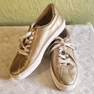 H&M Gold sneakers.